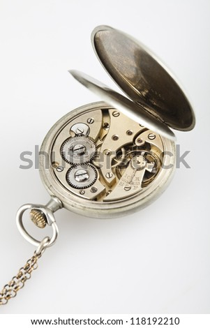 A vintage watch's gears, on white background. - stock photo