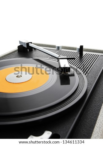 A vinyl record is spinning on the turntable