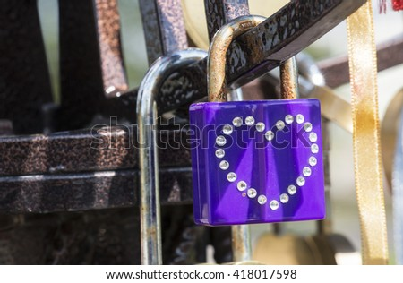 A violet heart is a lock, weighs - stock photo