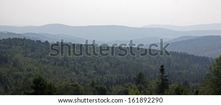 A vista displaying the Green Mountains of Vermont on the horizon.  - stock photo