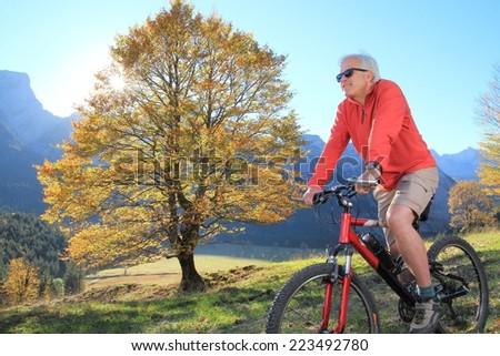 A Vital Senior Mountain biking - stock photo