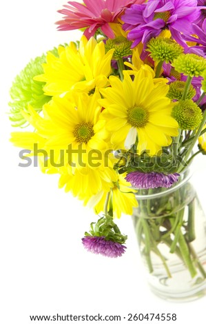 A vivid colored spring bouquet of fresh cut flower with a white background, perfect for Mothers Day or special occasion - stock photo