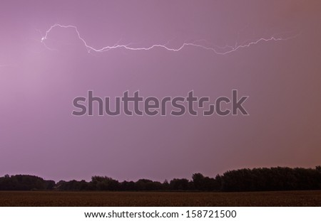 A vivid flash of lightning with space for your own text - stock photo