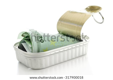 a wad of euro bills in a can on a white background - stock photo