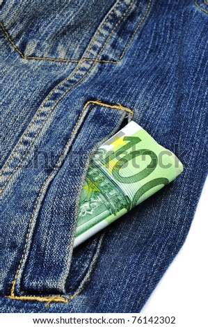 a wad of 100 euro bills in the pocket of a denim jacket