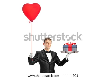 A waiter holding a red heart shaped balloon and a gift isolated on white background - stock photo