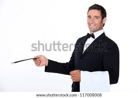 A waiter of a fancy restaurant. - stock photo