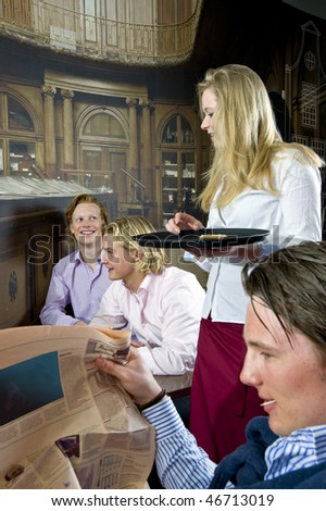 a waitress having a small chat with her customers - stock photo