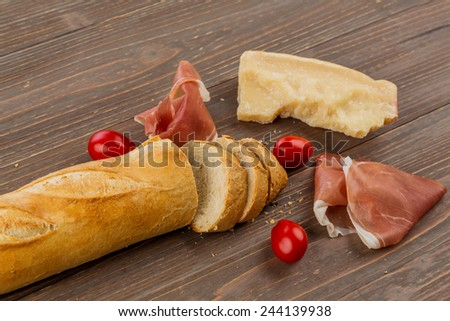 a wake-up from fresh white bread. food from the bakery - stock photo