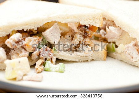 A waldorf inspired chicken salad sandwich on organic seed bread