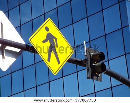 A Walk Sign on an Overhead City Post - stock photo