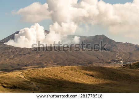 A walk to Viewpoint Smoke Gas Steam Crater of Mount Aso Volcano Caldera largest active Volcano in Japan Island eruption under Sunny Clear Blue Sky in Summer Daytime, Kumamoto, Kyushu - stock photo