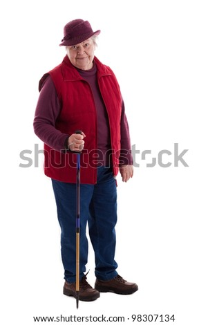 A walking female senior looks to viewer 2 - stock photo