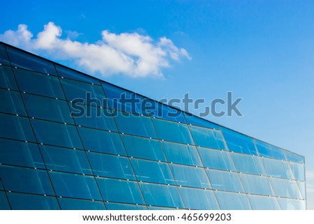 A wall consisting of grids of grass windows under blue sky. Taken at Marina Bay, Singapore.
