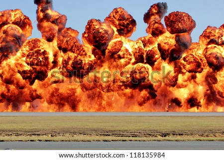 A wall of fire, explosion with heat and flame billowing and in motion. - stock photo