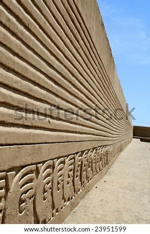 A wall of friezes at Chan Chan Ruins near Trujillo Peru - stock photo