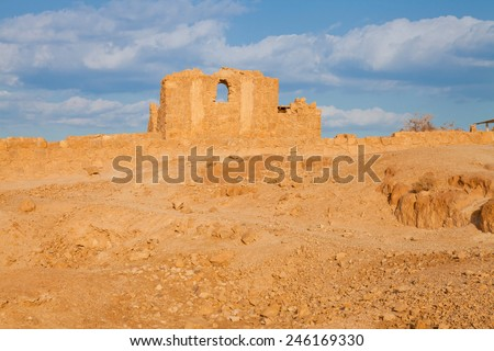 A wall with an arch in Massada fortress, Negev desert, Israel