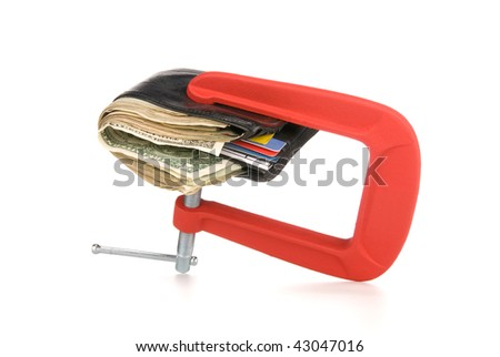 A wallet full of cash being squeeze during tough economic times.  Good image for financial inferences such as budgeting and spending control. - stock photo