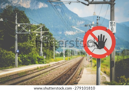 A Warning Sign At A Train Station In The Alps In Austria - stock photo