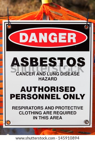 A warning sign at site being rehabilitated post asbestos contamination - stock photo