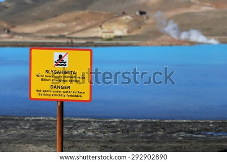 A warning sign near the waters of Bjarnarflag Geothermal Power Station in north Iceland - stock photo