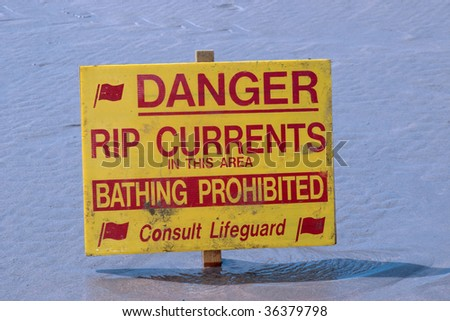 a warning sign on a beach in ballybunion ireland - stock photo