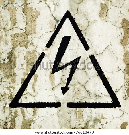 A warning sign painted on the wall - Electricity - stock photo