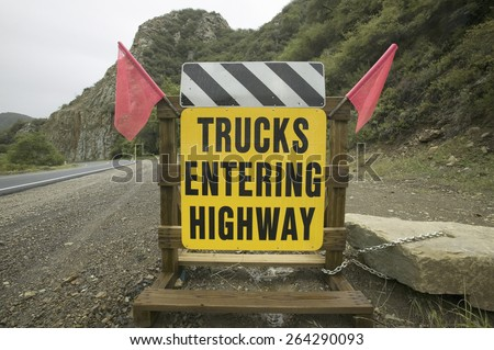 A warning sign stating Trucks Entering Highway on Route 33 near Ojai, California.