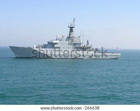 A warship sails by