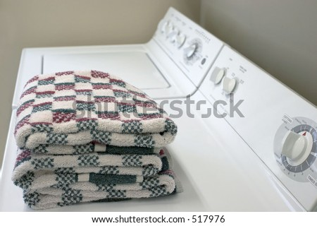 A washer and dryer with folded towels