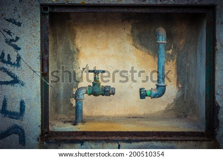 A water pipe with one piece missing in its middle - stock photo