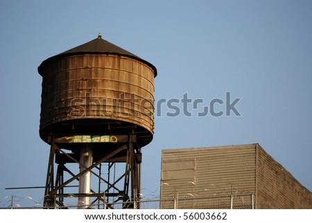 A water tower in New York City. - stock photo