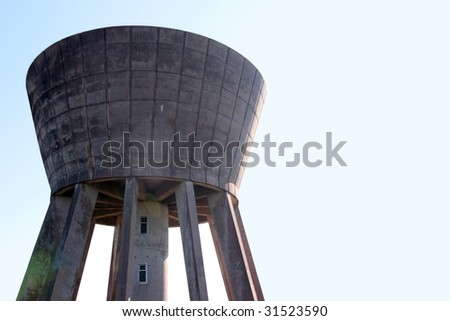 a water tower in the irish countryside on a hot day