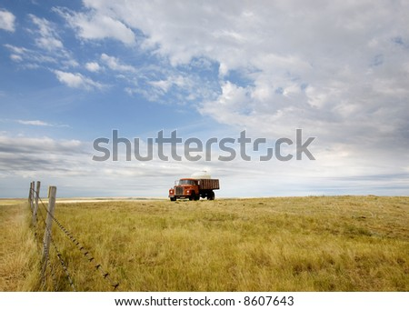 A water truck on the prairie - stock photo
