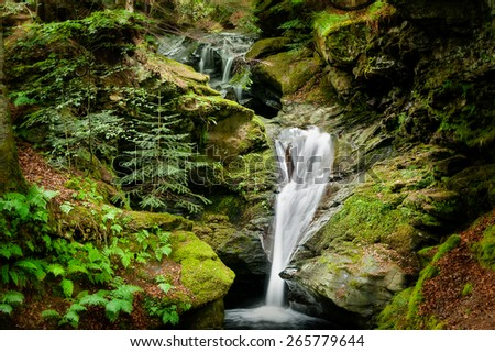 A waterfall at the Scottish village of Archan near Kenmore and Loch Tay. - stock photo