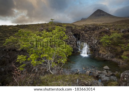 A waterfall near the Glennbrittle hostel at a weather changing moment.  - stock photo