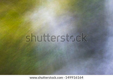 A waterfall shot with moving camera. A blurry nature abstract.  - stock photo