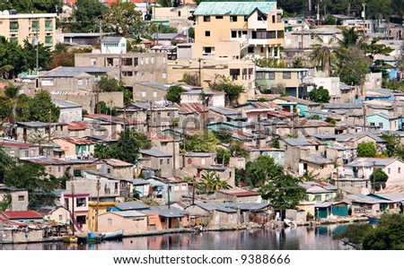 A waterfront slum in the Caribbean - stock photo