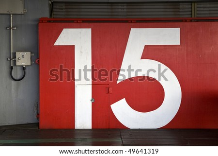 a watertight door in osaka japan near the bay, used for tsunami protection marked with the number 15 - stock photo