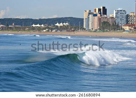 A wave breaks along the Golden Mile in Durban, South Africa. - stock photo