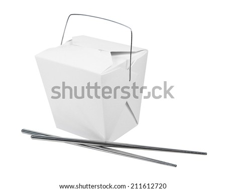 A wax paper box that is folded up to hold take out food items with metal chopsticks - stock photo
