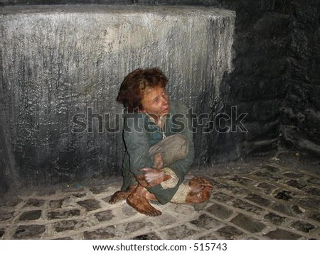 A wax statue of a young boy suffering from leprosy - stock photo
