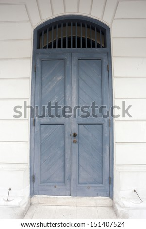 A weathered blue door on Bangkok, Thailand - stock photo