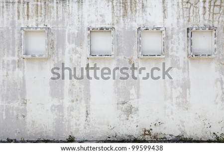 A weathered white plaster wall with window frame and blank space for text. - stock photo
