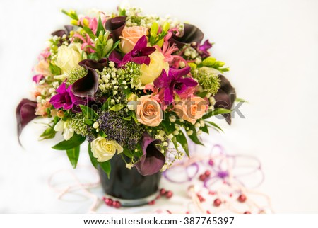 A wedding bouquet with brown callas in a brown vase