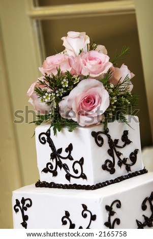 a wedding cake with pink roses. - stock photo