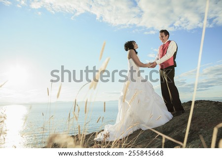 A wedding couple with sky on the background