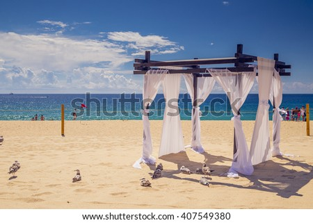 a wedding on the beach, empty set up - stock photo