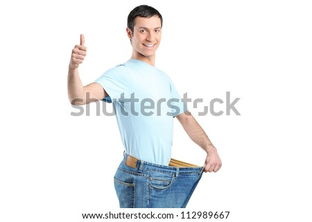 A weight loss male with thumb up isolated on white