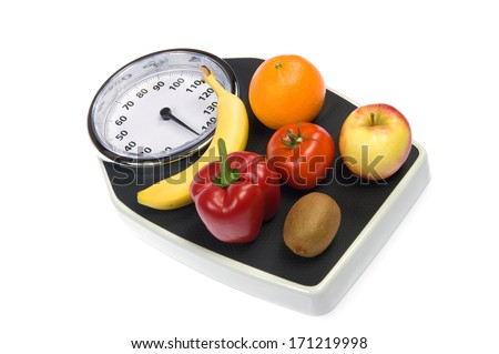 A weight scale with fruit